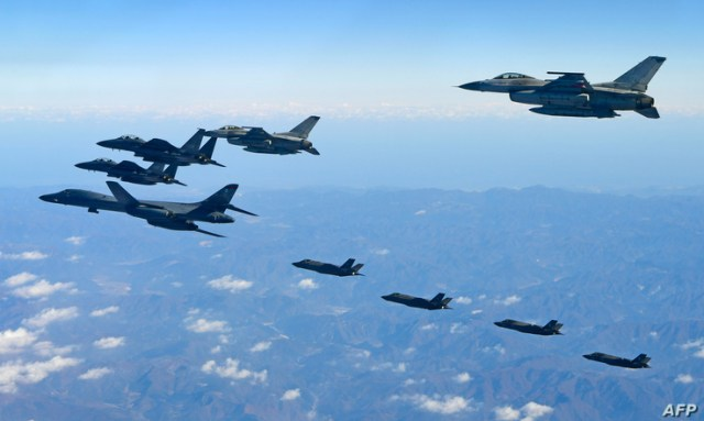 This handout taken and released by the South Korean Defence Ministry in Seoul on December 6, 2017 shows a US Air Force B-1B…