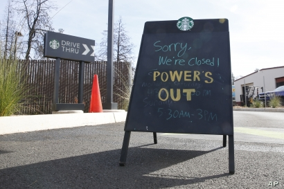 A sign at the entrance of the drive-thru at Starbucks warns customers the store is closed due to a power outage in Paradise, California, Oct. 24, 2019.
