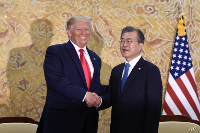 President Donald Trump and South Korean President Moon Jae-in shakes hands at the start of a bilateral meeting at the Blue House in Seoul, Sunday, June 30, 2019.