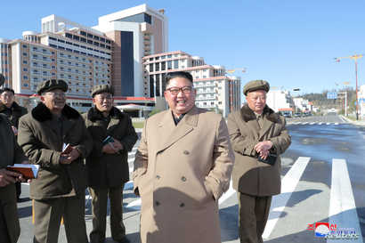 North Korea's leader Kim Jong Un provides field guidance to construction sites in Samjiyon County, in this undated picture…