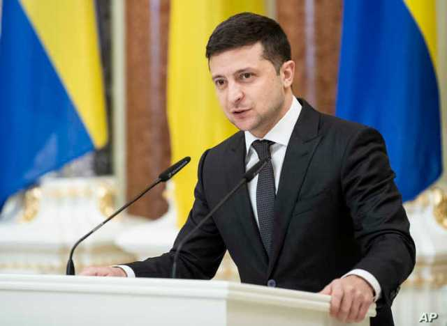 Ukrainian President Volodymyr Zelenskiy speaks in Kyiv, Dec. 4, 2019.