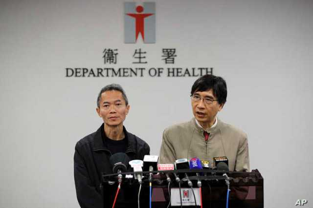 Professor Yuen Kwok-yung, right, speaks next to Wong Ka-hing, the Controller of the Centre for Health Protection
