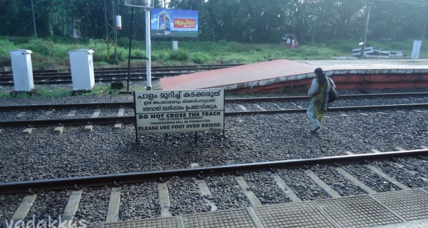 People Ignore warnings and cross the railway tracks