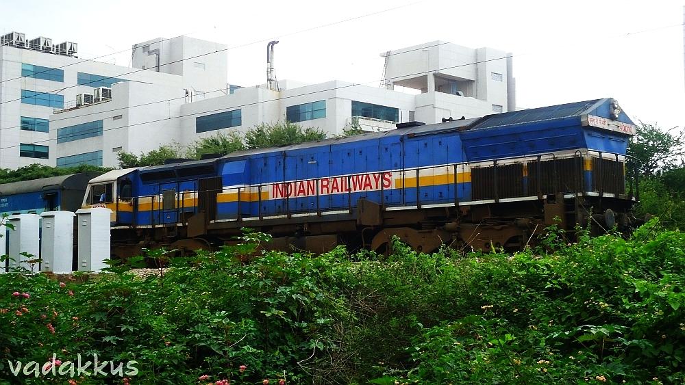 KJM's WDP4B #40010 with an express near Krishnarajapuram Cabin