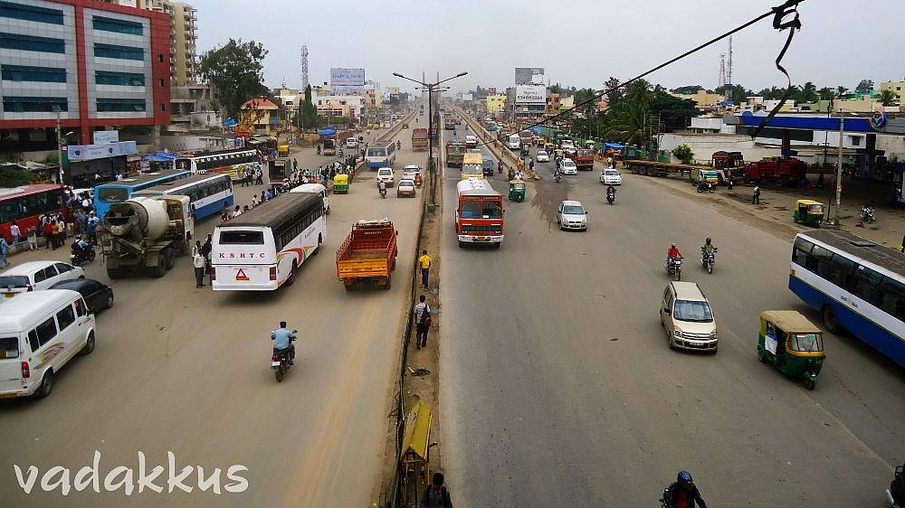 View of KR Puram Tin Factory bus stop from foot over bridge