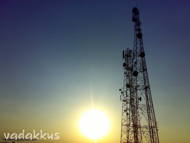 A Spectacular Sunset Against Mobile Towers