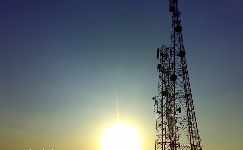 Picture of a beautiful sunset with mobile towers in backdrop at Tumkur.