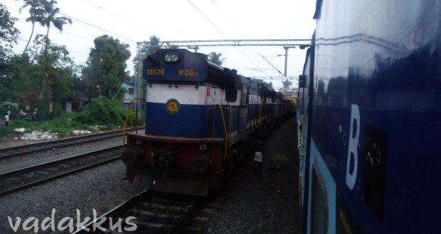 Frieght with WDG3A 13536 overtakes stopped Island Express at Kalamasserry in Kerala