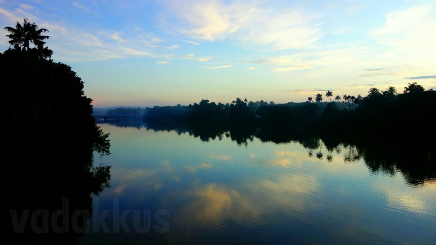 Nature's Mirror: The Serene Blue Muvattupuzha River at Dawn
