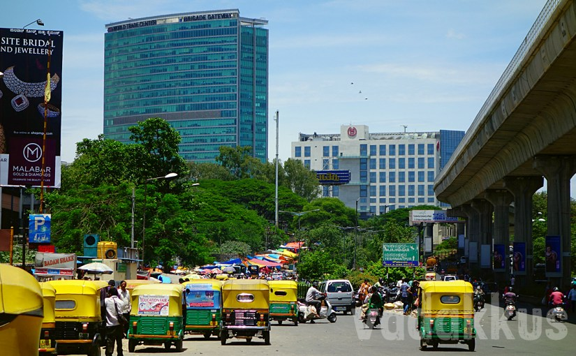 A Bangalore Scene: An Elevated Metro Line, Some Autos and a Skyscraper
