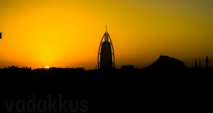 The Dubai Jumeirah skyline including the Burj al Arab hotel as seen as a sunset silhouette