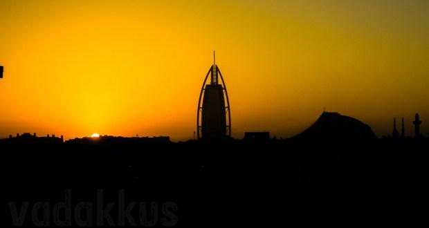 The Dubai Jumeirah skyline including the Burj al Arab hotel as seen as a sunset silhouette