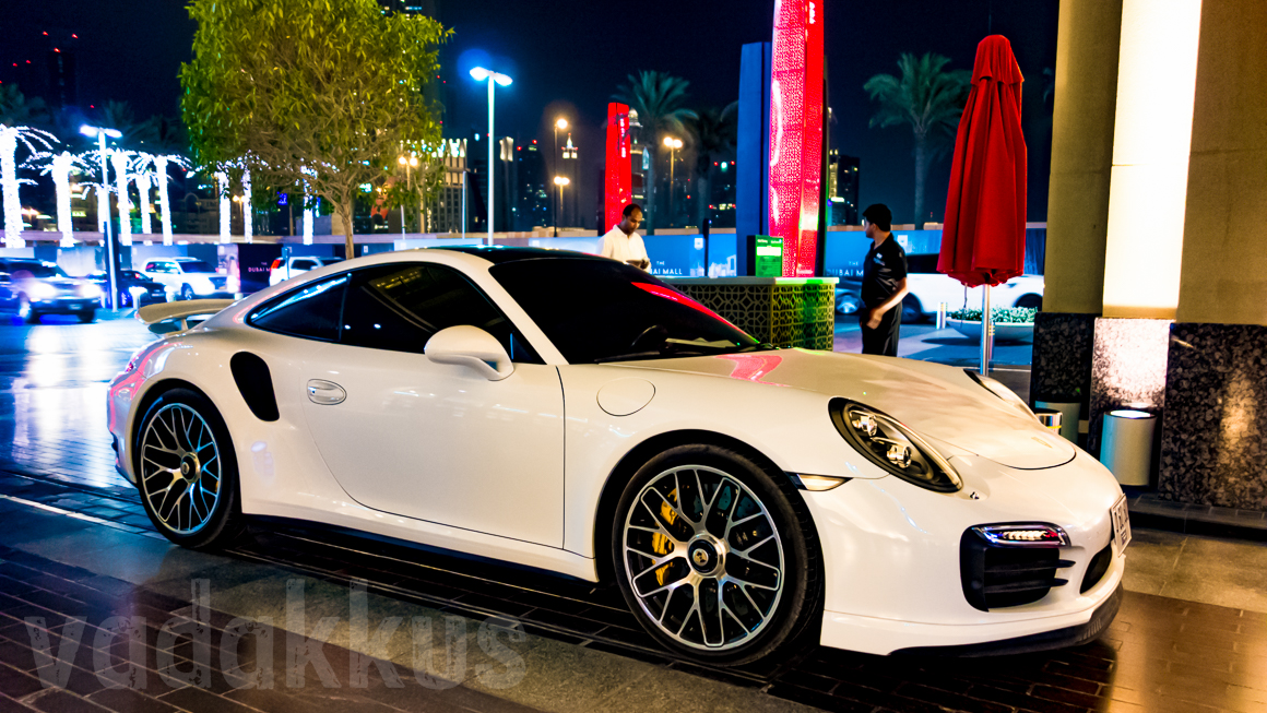 The Curves of a Pearl White Porsche Against a Blue Dubai Night