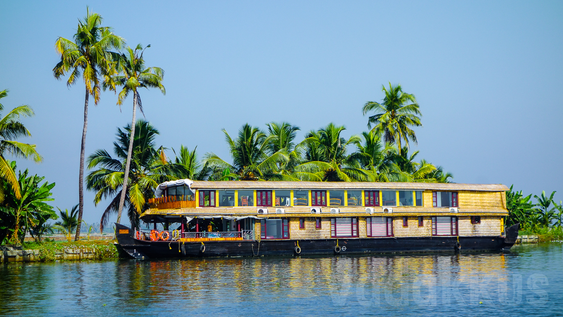 A Double Decker Houseboat Under a Perfectly Blue Sky in Kerala
