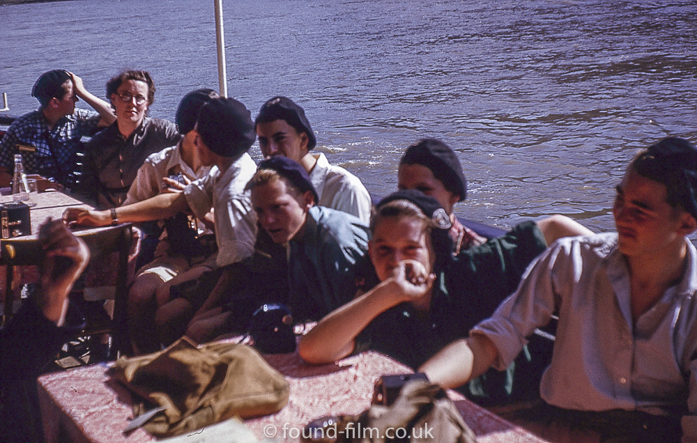 A group sitting near the river