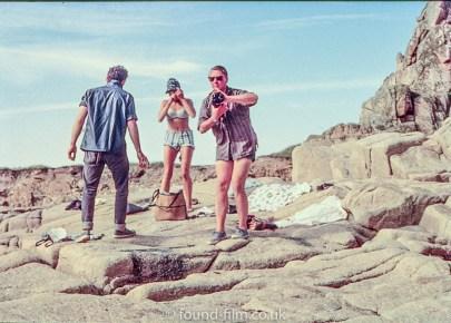 A group on a rocky beach