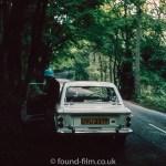 Hillman Imp coupe under trees