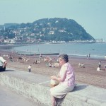 Lady sitting on the seawall at Minehead beach