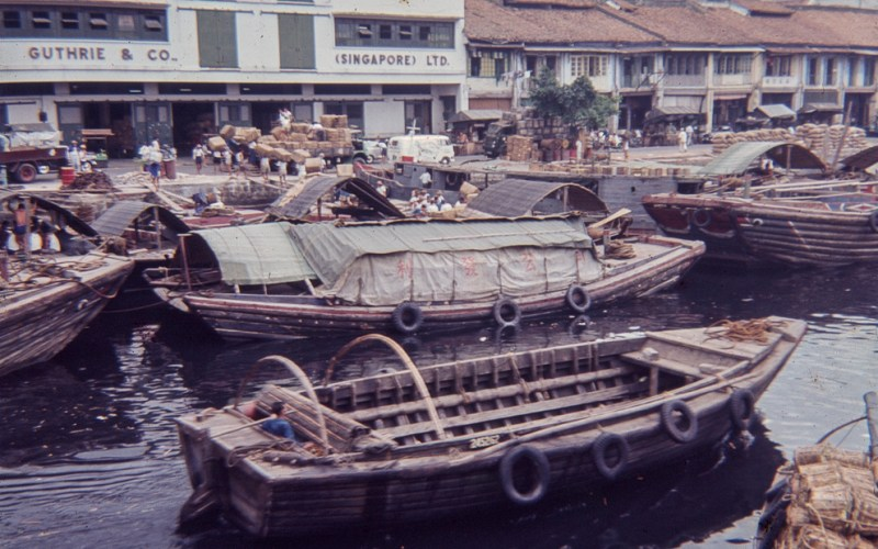 Boats in Singapore near Guthrie and Co