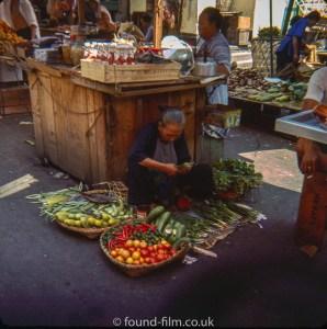 Fruit and veg seller in Singapore market 1960s