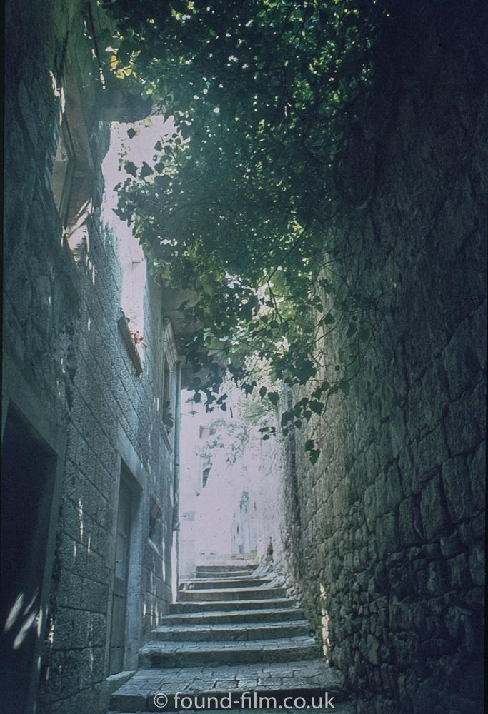 Narrow sunlit passage