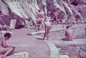 Woman on beach in sunglasses