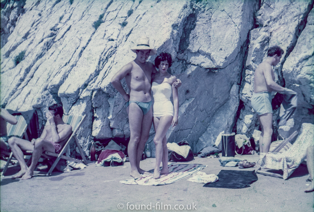 A couple pose at the seaside - possibly mid 1950s