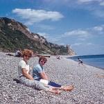 Women sitting on a pebble beach