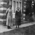 Mother and Daughter outside their house in 1920s