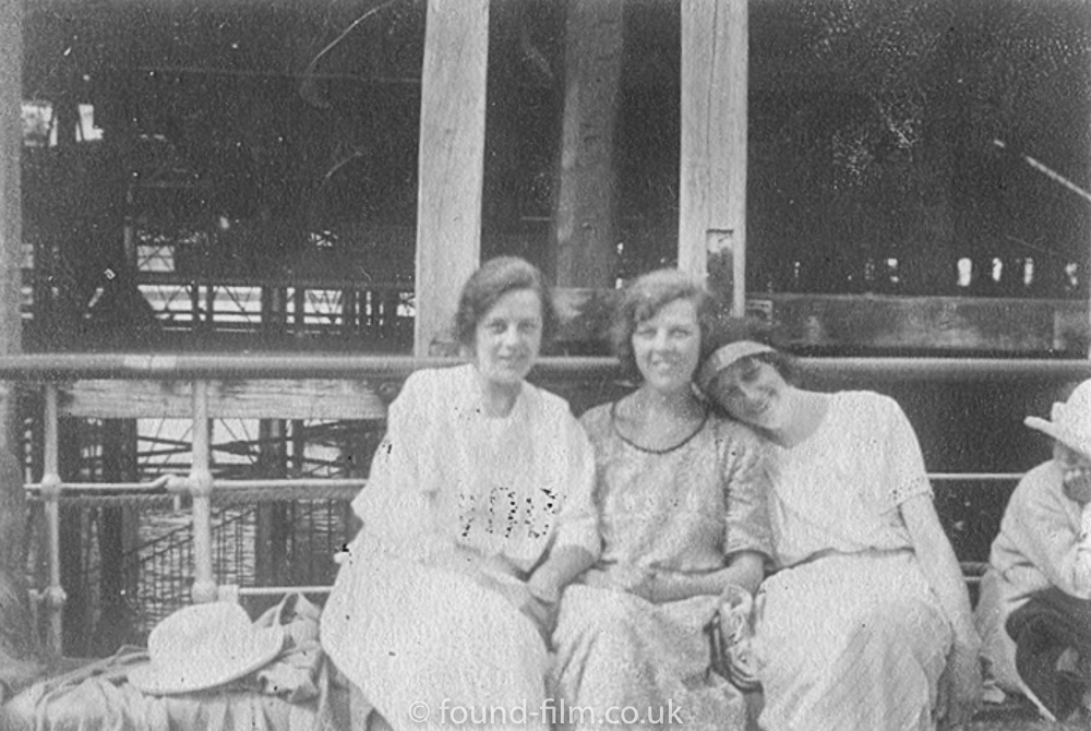 Three young ladies on a bench, mid 1920s