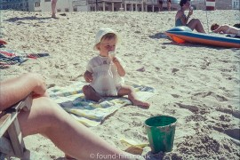 Baby on beach with ice-cream