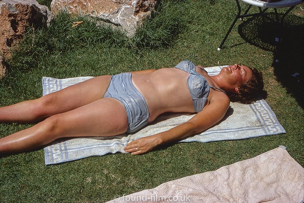 Sunbathing woman in bikini, August 1969
