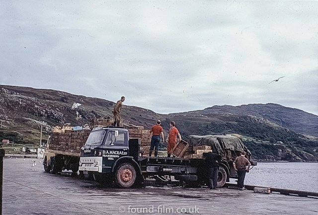 A lorry being loaded with herring on the dock at Ullapool in 1967