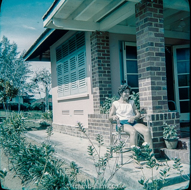 Woman sitting in her front porch at RAF Seletar