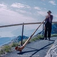 Alpine horn blower on Pilatus range in Switzerland 1962