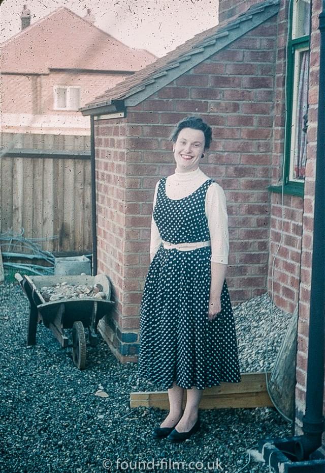 Woman posting in back yard