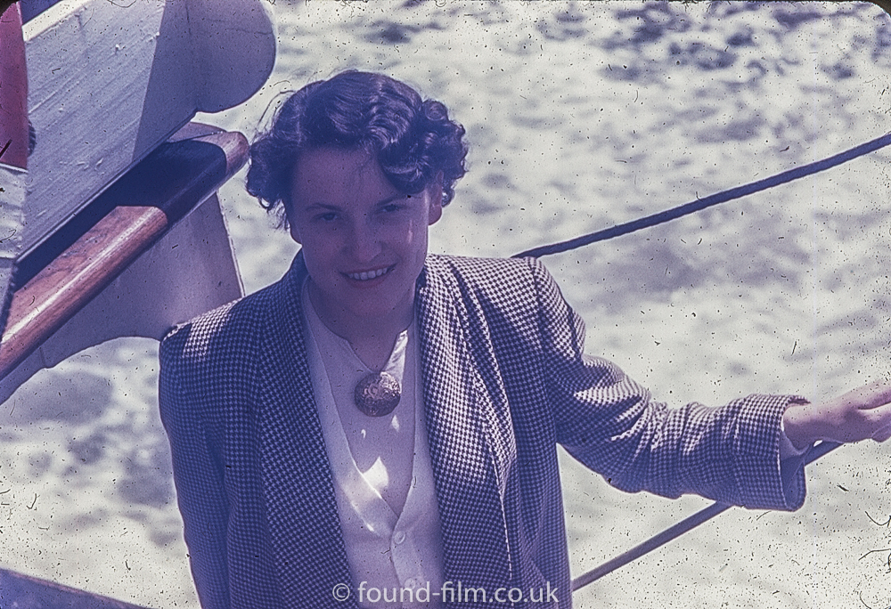 Woman in a Tweed jacket on a boat