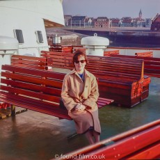 Woman seated on a boat, late 1950s