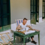 kodachrome red border colour slides - Man sitting at a table