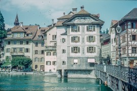 Picture of the Lakes and Mountains of Europe - The bridge to the old town in Lucerne taken in the late 1950s