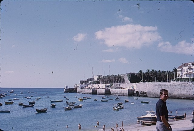 A Kodachrome slide depicting a holiday scene of a bay with boats and people