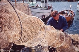 A Fisherman mending nets