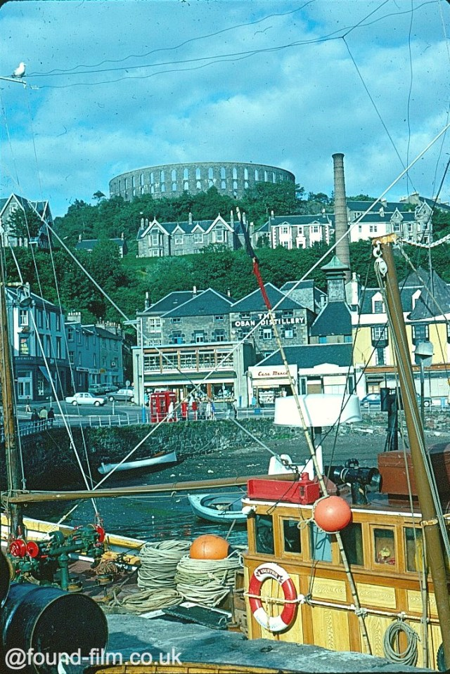 Fishing boats, distillery and tower and Oban