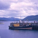 A Kodachrome picture of a small fishing boat moored at the quayside in Ullapool in August 1967