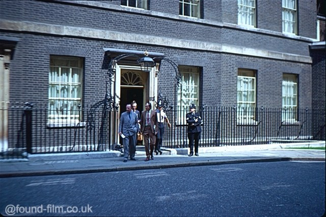 No 10 Downing street with a group of people leaving