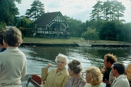 People on a boat enjoying a Thames river trip