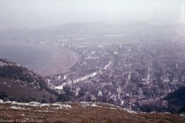 An unknown coastal town from a hill above it - c 1955