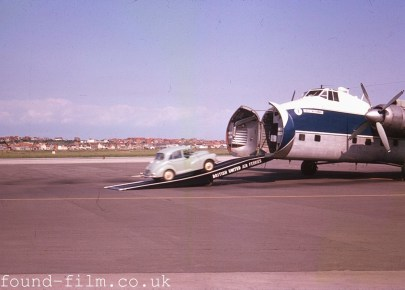 Morris Minor being driven onto a cargo plane, about 1964