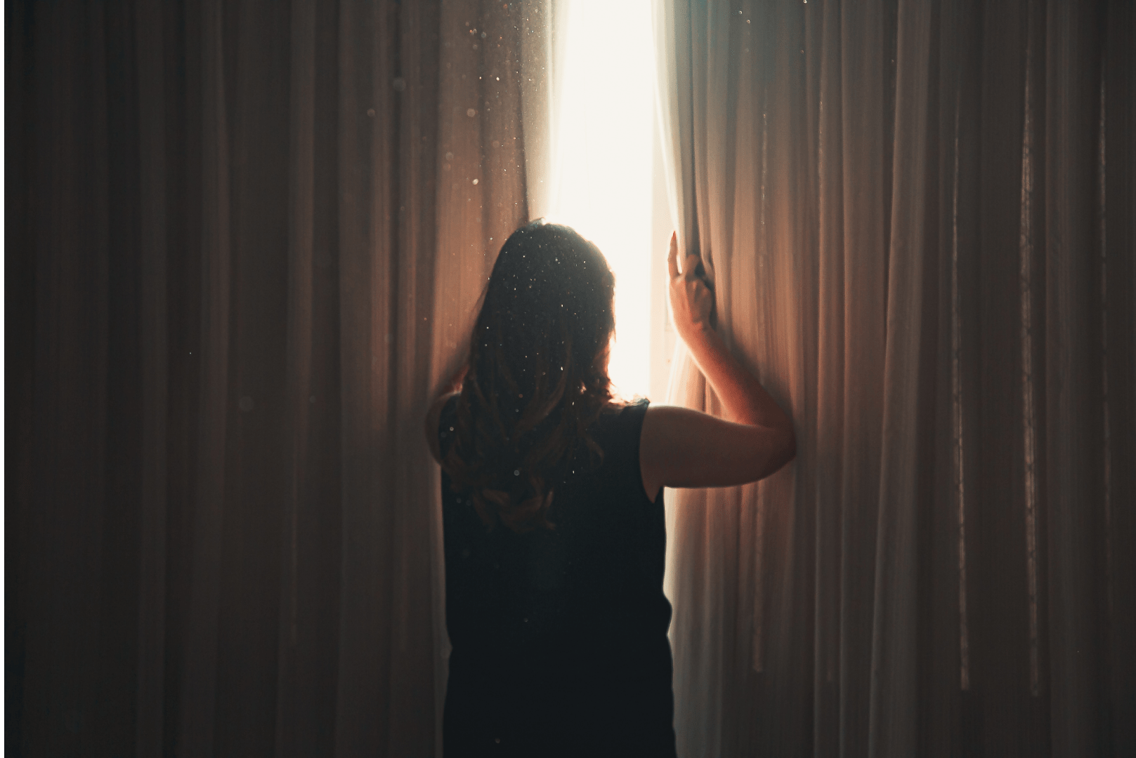 Curing depression with CBD, woman with depression peeking in the window