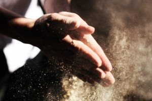 hands covered in dust